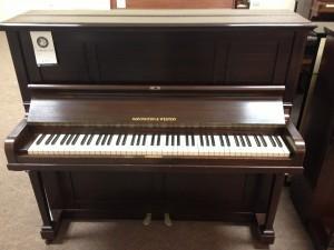 Monington & Weston piano that is in good condition
