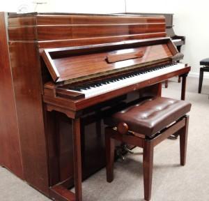 Mahogany Steinmetz piano, really good for the beginner